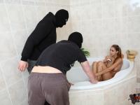Intruders interrupt Nika's slippery bathroom fun with their huge dicks in her wet pussy
