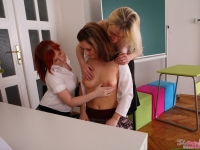 Blonde lesbian teacher seduce two sexy female students into 3-way action
