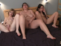 Naked lesbian threesome shows breast play, pussy licking and 69 action